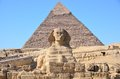 Great Sphinx of Giza against the Pyramid of Khafre Royalty Free Stock Photo