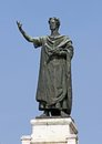 Great statue of the famous poet virgil huge in center in city mantua in italy Stock Photos