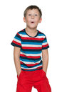 Great surprise a surprised and shocked boy is standing with an open mouth on the white background Royalty Free Stock Photo