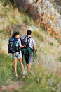 The great treck couple walking along a hiking path Stock Photo