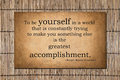 The greatest accomplishment emerson quote to be yourself in a world that is constantly trying to make you something else is ralph Stock Photo
