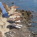 Greece, blue stairs to tranquil beach with umbrellas and chairs Royalty Free Stock Photo