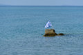 Greece flag in Aegean sea Royalty Free Stock Photo