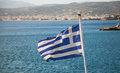 Greece flag wavy on blue sea background Royalty Free Stock Photos