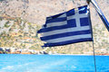 Greece flag wavy on blue sea background Stock Images