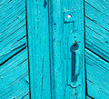 Greece home texture of a blue antique wooden old door in santori abstract Stock Image