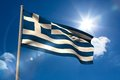 Greece national flag on flagpole blue sky background Royalty Free Stock Photos