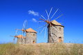 Greece patmos the mills of chora these historic windmills in have been restored are equipped with jib sails which are simple Royalty Free Stock Photography