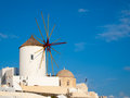 Greece windmills tradational and white buildings at oia santorini Royalty Free Stock Photos