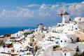 Greece windmills tradational and white buildings at oia santorini Stock Photography