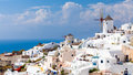 Greece windmills tradational and white buildings at oia santorini Stock Images