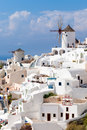 Greece windmills tradational and white buildings at oia santorini Royalty Free Stock Photography