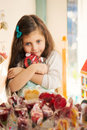 Greed little girl with lollipop in candy store blue eyes holding hands Royalty Free Stock Images