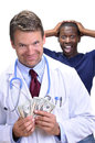 Greedy doctor white male with handful of money and smirky smile walks away from upset male patient on white background Stock Photography