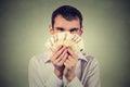Greedy man with euro banknotes bills Royalty Free Stock Photo