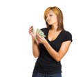 Greedy woman counting money Royalty Free Stock Photo
