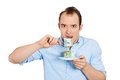 Greedy woman eating cash Stock Photography