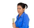 Greedy woman holding cash closeup portrait of young corporate business employee worker student dollar banknotes tightly isolated Royalty Free Stock Photo