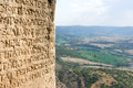 Greek alphabet ancient writing chiselled on stone Royalty Free Stock Image