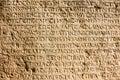 Greek alphabet ancient writing chiselled on stone Stock Photos