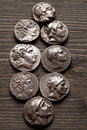 Greek ancient silver coins on a wooden table Royalty Free Stock Photo