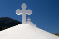 Greek church crosses the white on the top of a typical Royalty Free Stock Photos