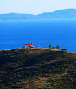 Greek church on hill overlooking sea Royalty Free Stock Photos