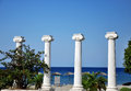 Greek columns in the park on the city beach Stock Photo