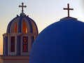 Greek cupola at sunset view of traditional church with crosses on the island of santorini Royalty Free Stock Image