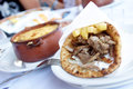 Greek dinner plate with gyros and pot of meat with cheese Royalty Free Stock Photos