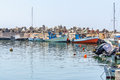 Greek fishing boats stay parked at port of Ierapetra town Royalty Free Stock Photo