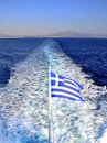 Greek flag at the back of a ferry Royalty Free Stock Photo