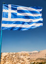Greek flag on the blue sky Royalty Free Stock Photo