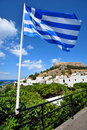 Greek flag flying in the city of lindos on the island of rhodes greece Royalty Free Stock Image