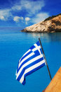 Greek flag in front of Porto Katsiki beach, Lefkada Royalty Free Stock Photo