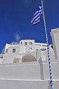 Greek flag on pole santorin a island Royalty Free Stock Photos