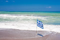 Greek flag at sea side Royalty Free Stock Photography
