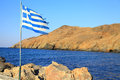 Greek flag at small village panormo at crete greece Royalty Free Stock Photos