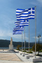 Greek flags on flagpoles waving with blue sky in samos greece Royalty Free Stock Photos