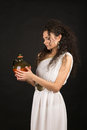 Greek girl with jug curly in a toga hold a Royalty Free Stock Photography