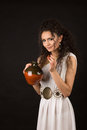 Greek girl with jug curly in a toga hold a Stock Image