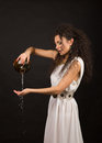 Greek girl with jug curly in a toga pouring water from a Royalty Free Stock Photo