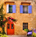 Greek house facade of a traditional stone in the old town of rhodes greece Stock Image