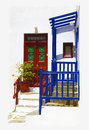 Greek house in mykonos red and blue entrance to a mediterranean island Royalty Free Stock Photos