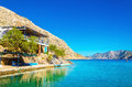 Greek house with terrace over sea bay, Greece Royalty Free Stock Photo