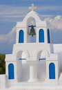 Greek island church beautiful traditional white belfry on the of santorini Royalty Free Stock Photo