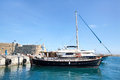 Greek island crete in the cyclades sightseeing on the old port with fort and boats blue sky Stock Images