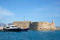 Greek island crete in the cyclades sightseeing on the old port with fort and boats blue sky Stock Photography