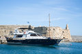 Greek island crete in the cyclades sightseeing on the old port with fort and boats blue sky Royalty Free Stock Image