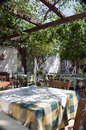 Greek island taverna restaurant in garden Royalty Free Stock Photo